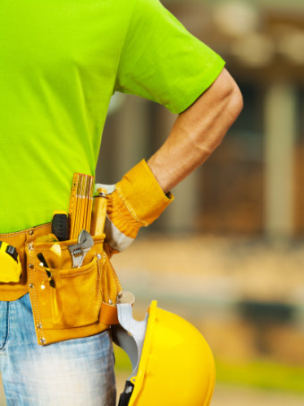 Person wearing belt with work tools & hard hat